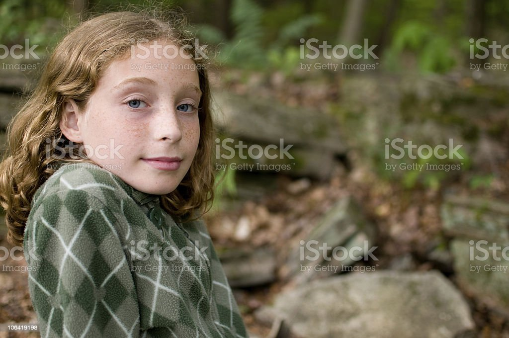 tween girl with a slight smile stock photo