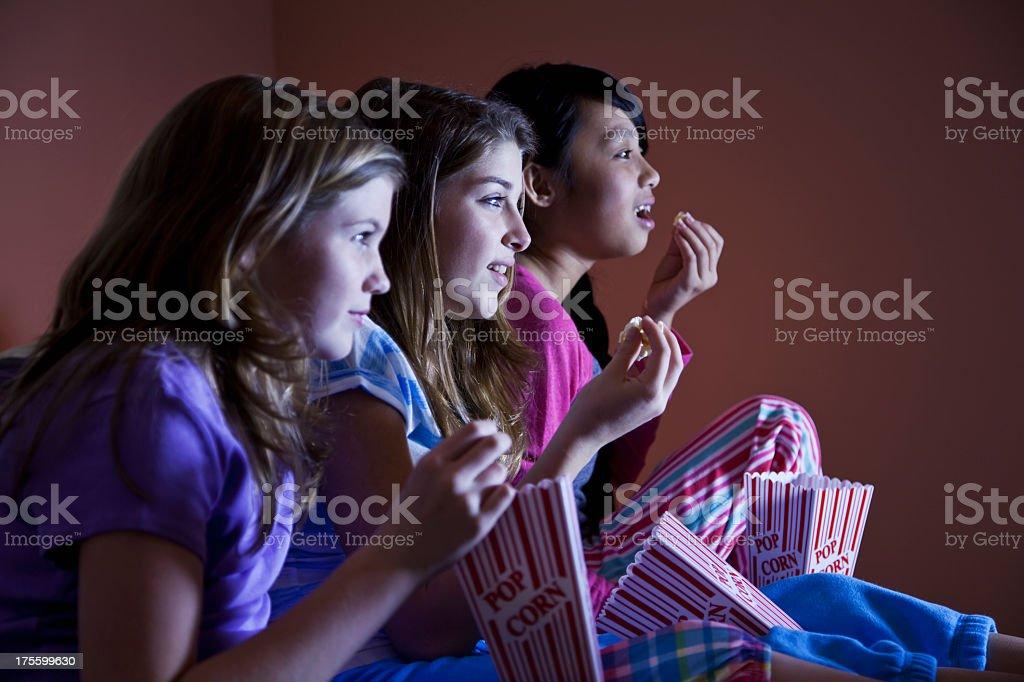 Tween girls watching TV stock photo