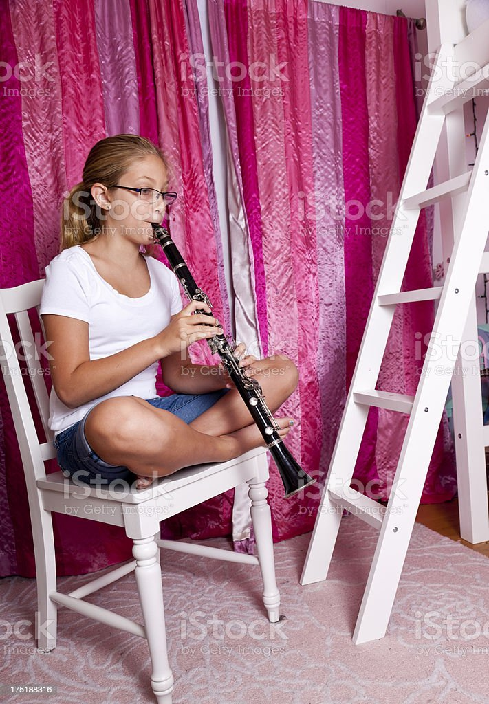 tween playing the clarinette royalty-free stock photo