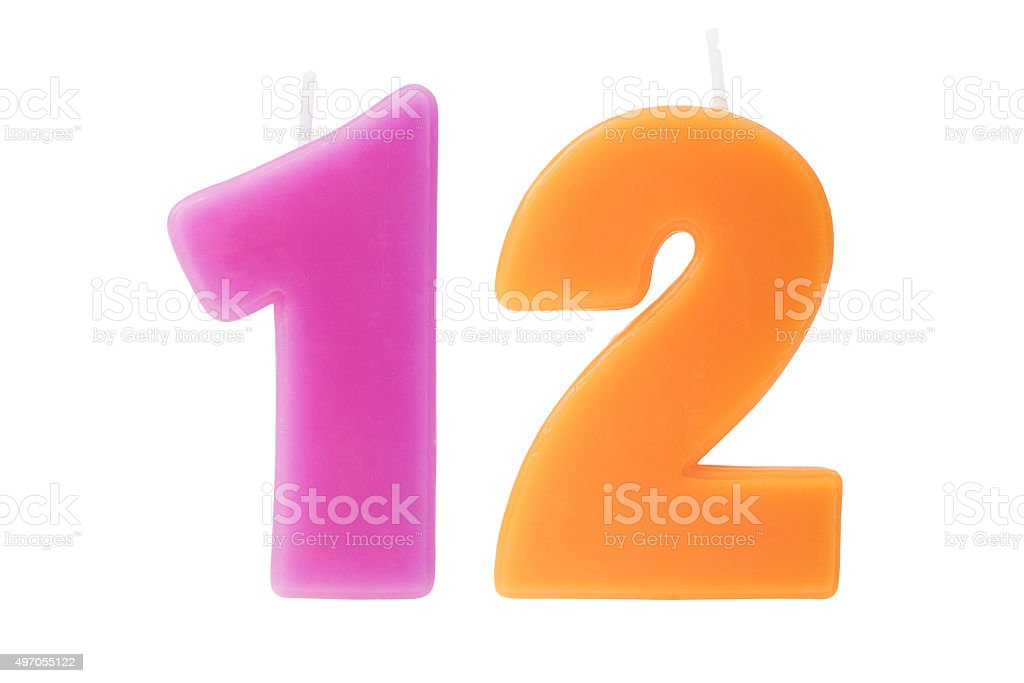 Twelfth birthday candles isolated stock photo