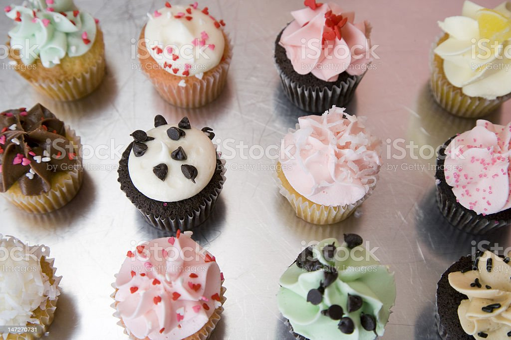 Twelve Assorted Cupcakes royalty-free stock photo