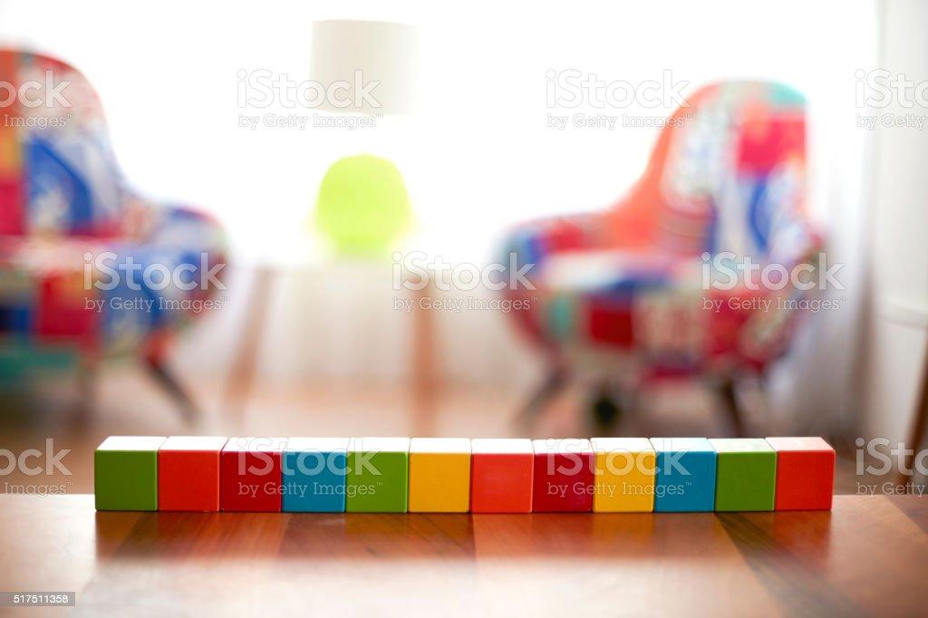 Twelve Blank colourful building blocks stock photo