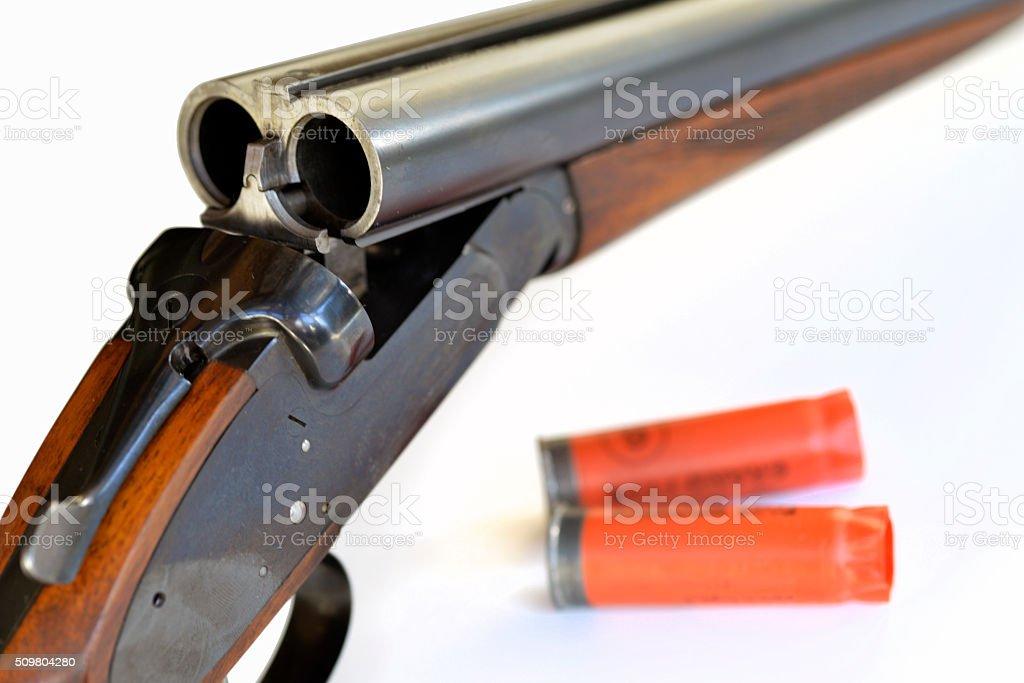 twelve bore shotgun and crtridges stock photo