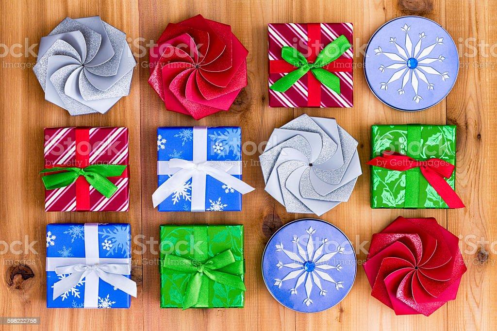 Twelve cute little Christmas gift boxes stock photo