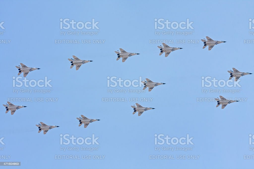 Twelve MiG-29 fighters form figure six against blue sky background royalty-free stock photo