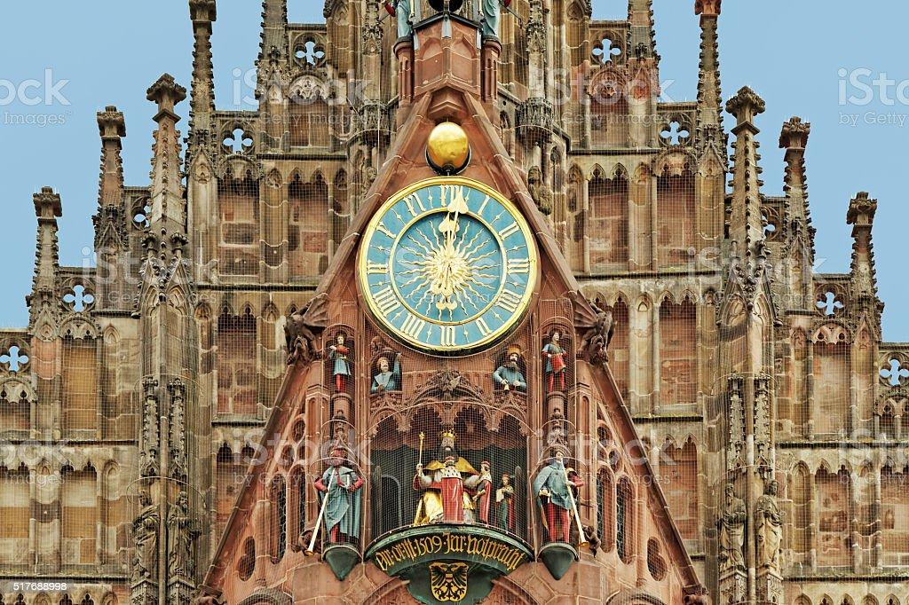 twelve o clock - Frauenkirche in Nuremberg with famous carillion stock photo