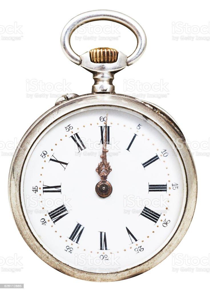 twelve o'clock on the dial of retro pocket watch stock photo