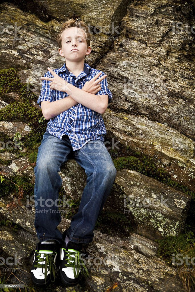 Twelve year old boy with attitude on school field trip stock photo