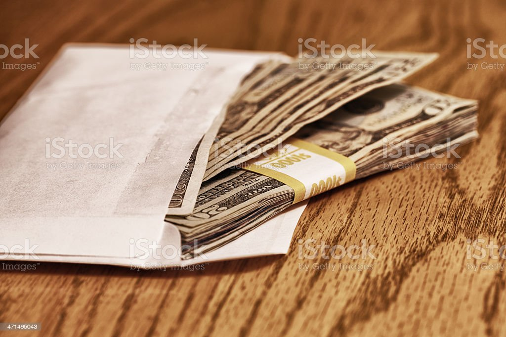 Twenty Dollar Bills Stuffed in Grubby Envelope royalty-free stock photo