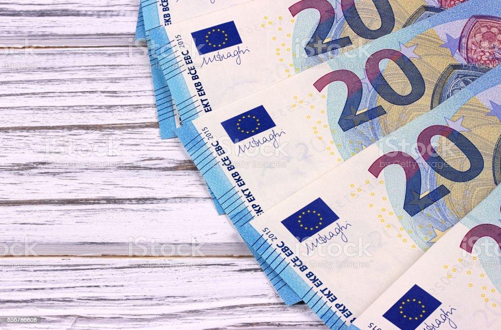 Twenty euro banknotes on white wooden background. stock photo