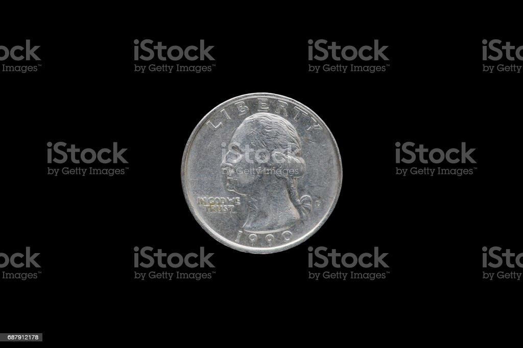 Twenty five American cents (Quarter Dollar) isolated on black background. stock photo