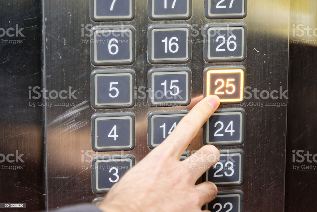 Twenty five floor elevator button with light and finger stock photo
