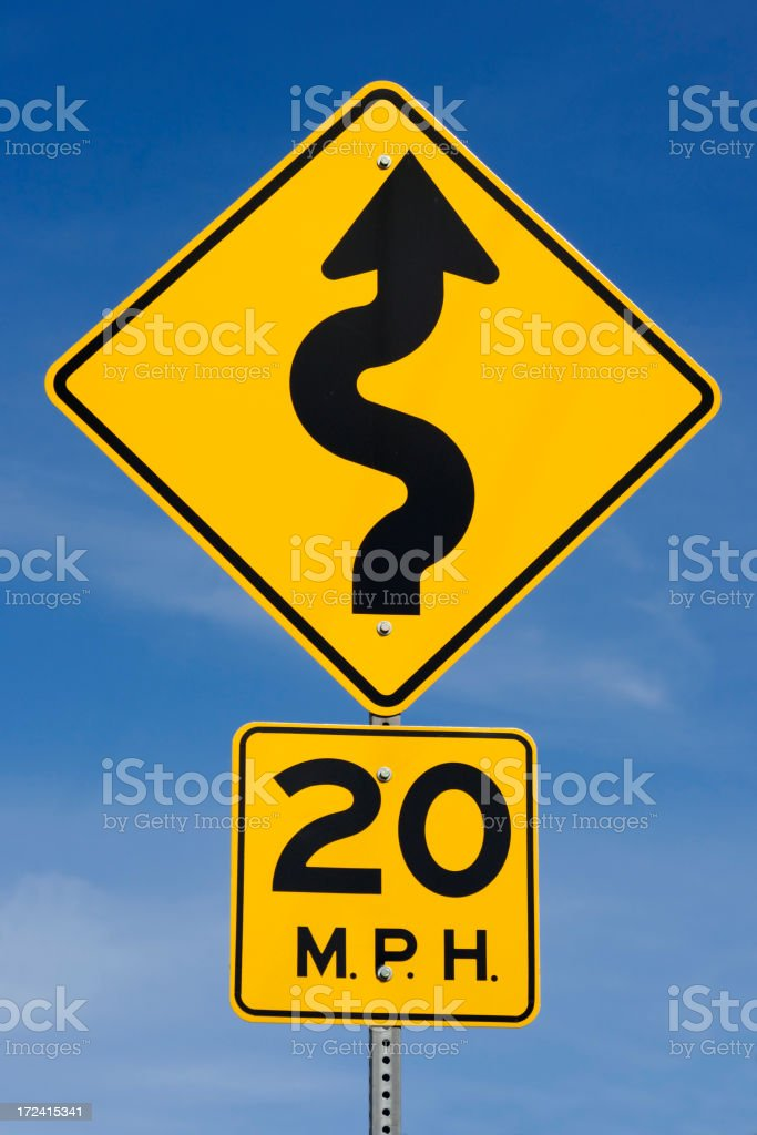 Twenty MPH Curved Road Yellow Traffic Sign, Blue Sky Background stock photo