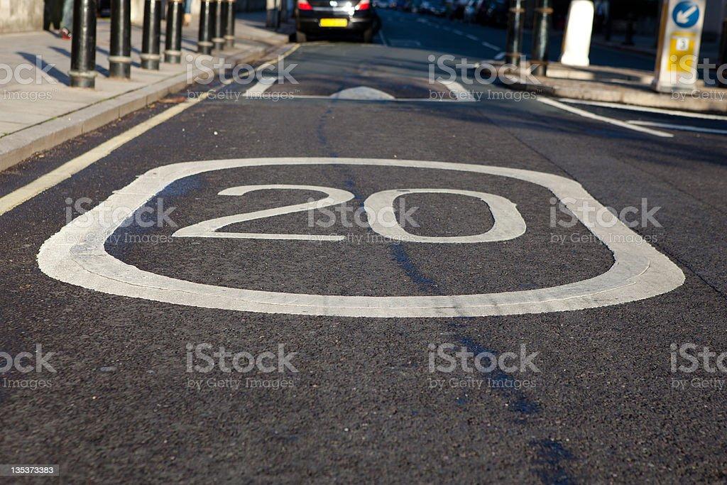 Twenty MPH speed sigh on road stock photo