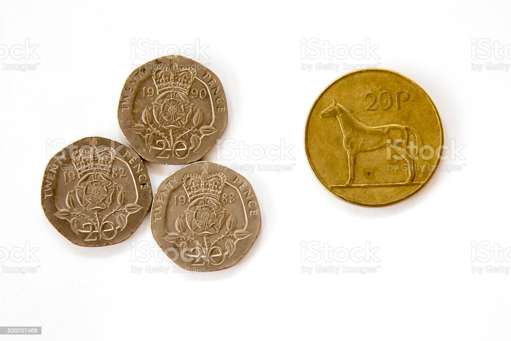 Twenty pence English coins and an obsolete Irish 20 pence stock photo