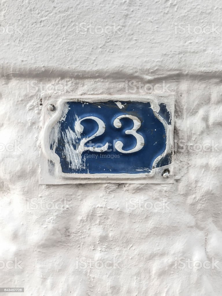 twenty three door number on wall of a building stock photo