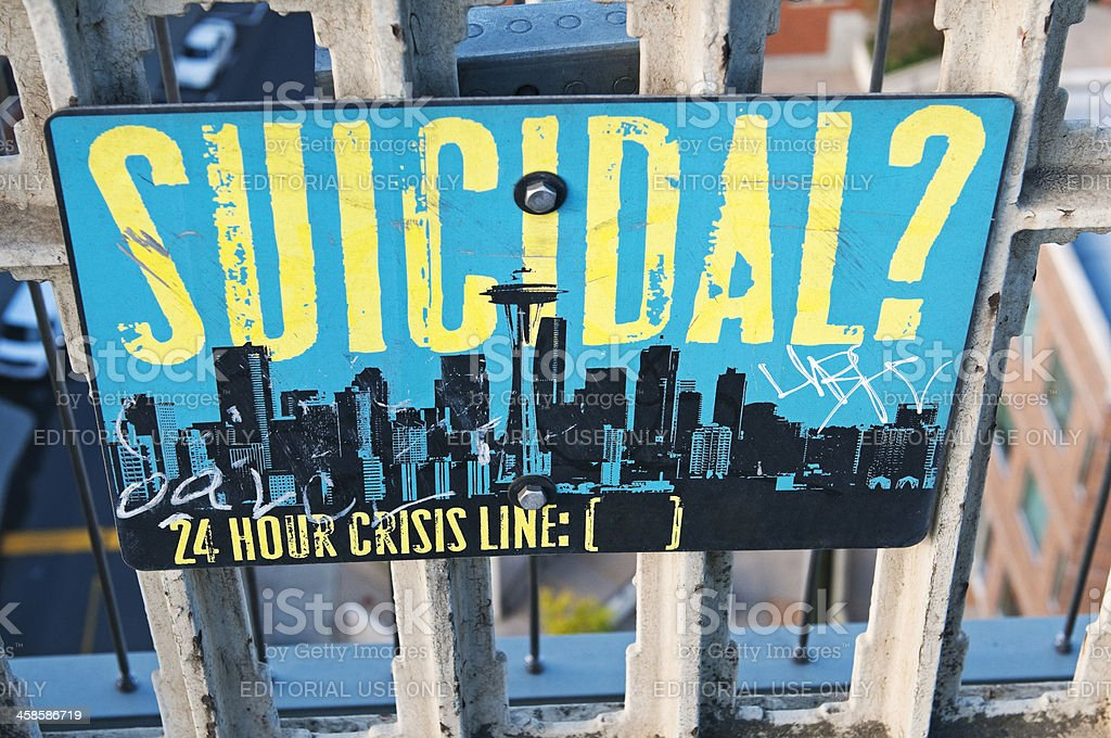 Twenty-four crisis line sign posted on high bridge stock photo