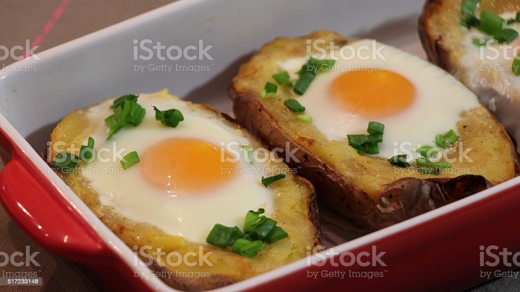 Twice baked potato in red baking dish stock photo