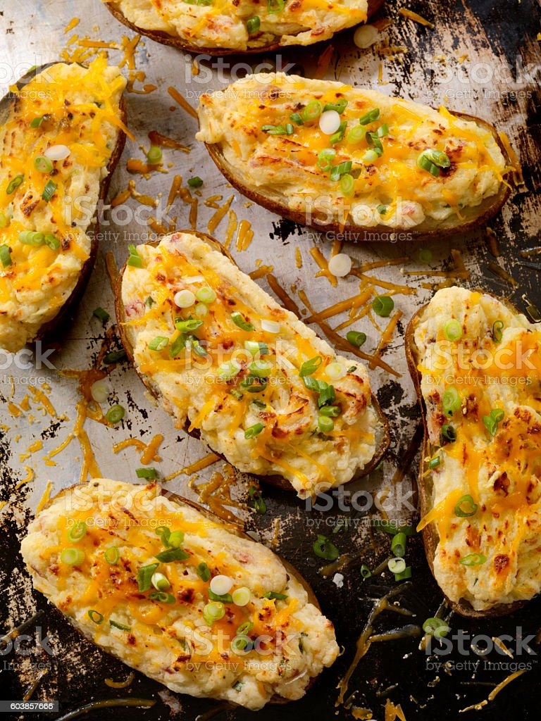 Twice Baked, Stuffed Potatoes with Cheese and Green Onion stock photo
