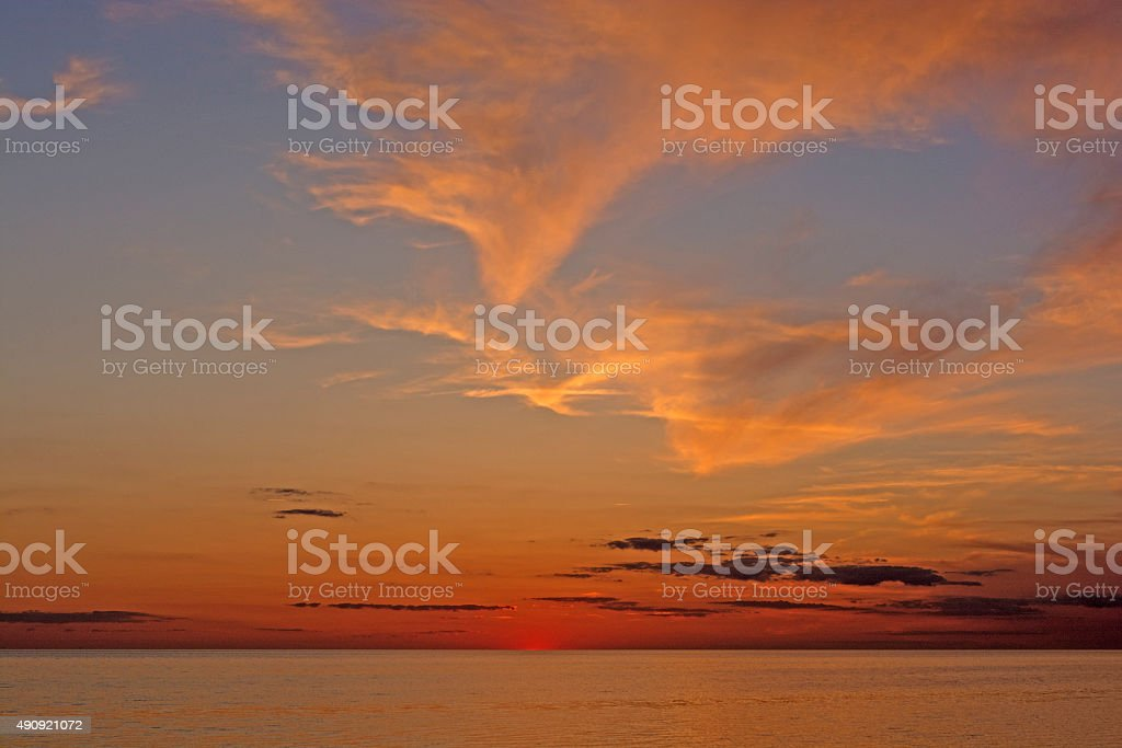 Twilght and Clouds after Sunset on the Ocean stock photo