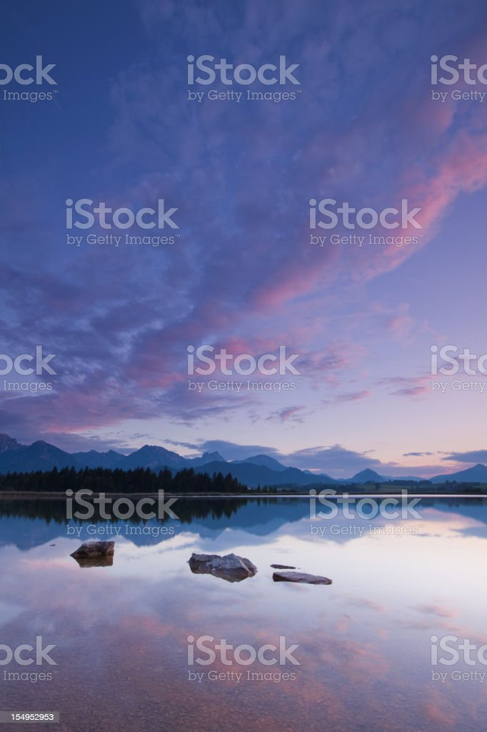 twilight at lake hopfensee stock photo