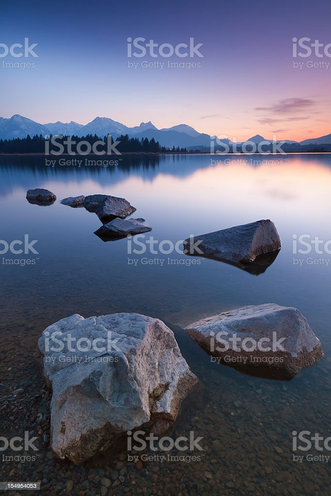 twilight at lake hopfensee stock photo