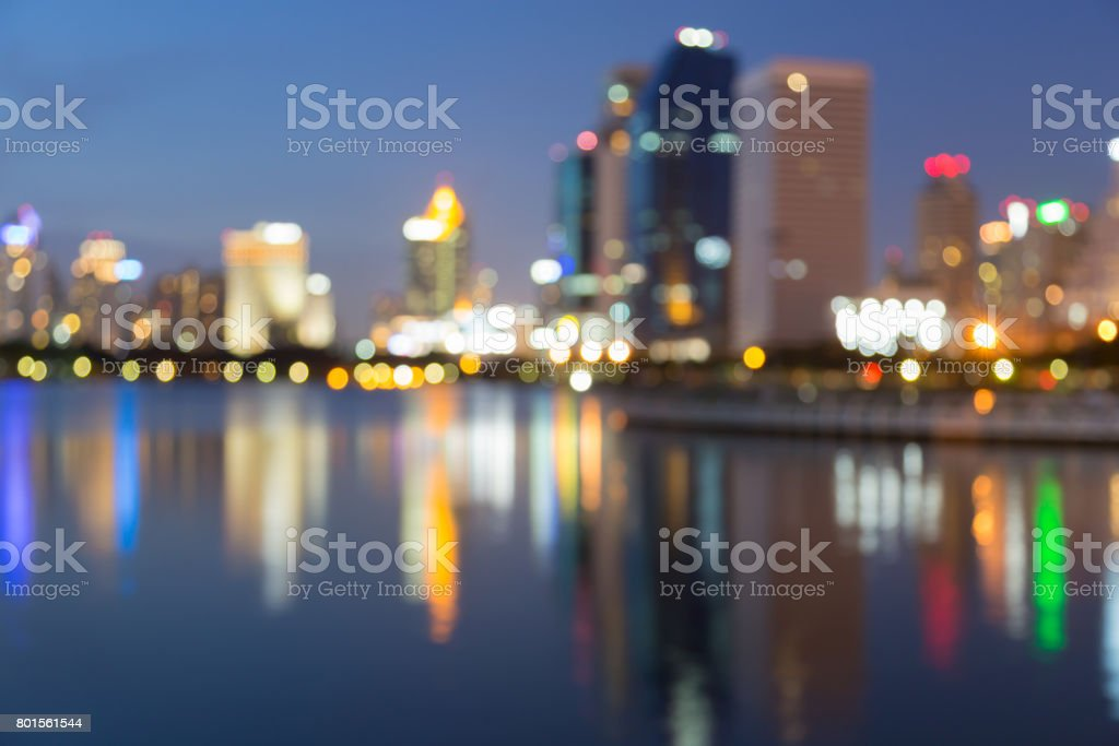 Twilight blurred bokeh office building with water reflection stock photo