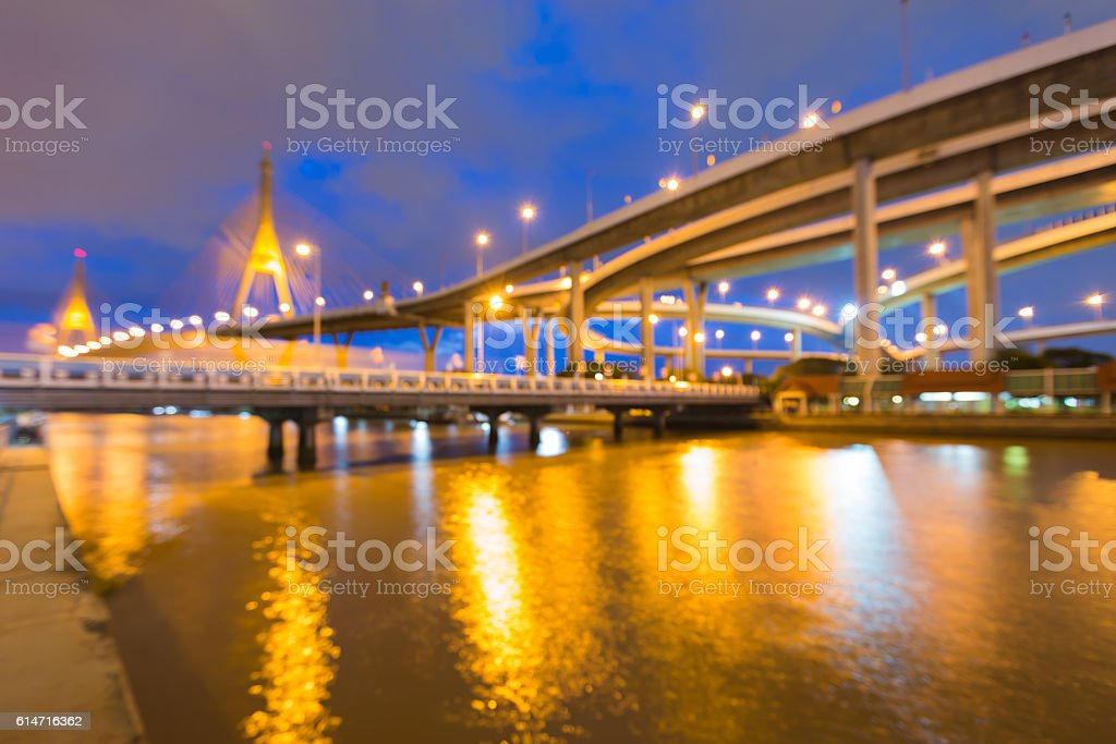 Twilight blurred highway interchanged water front, abstract background stock photo