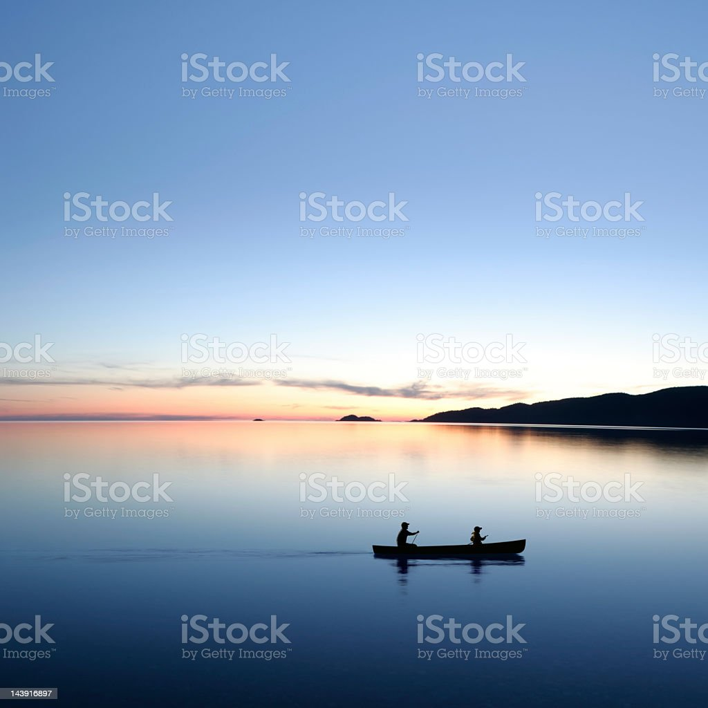 XXL twilight canoeing stock photo