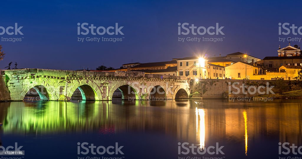 Twilight. Evening light on historical Tiberius bridge. Rimini stock photo