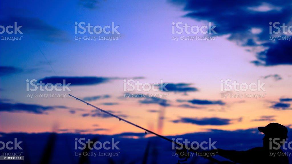 Twilight fishing stock photo