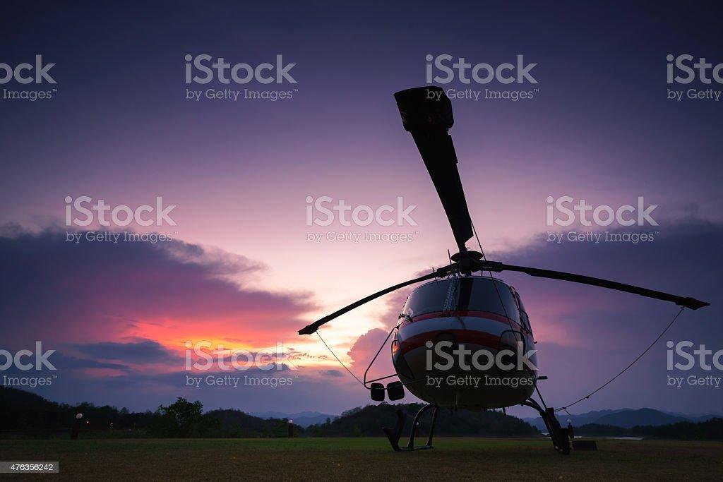 Twilight helicopter on the helipad. stock photo
