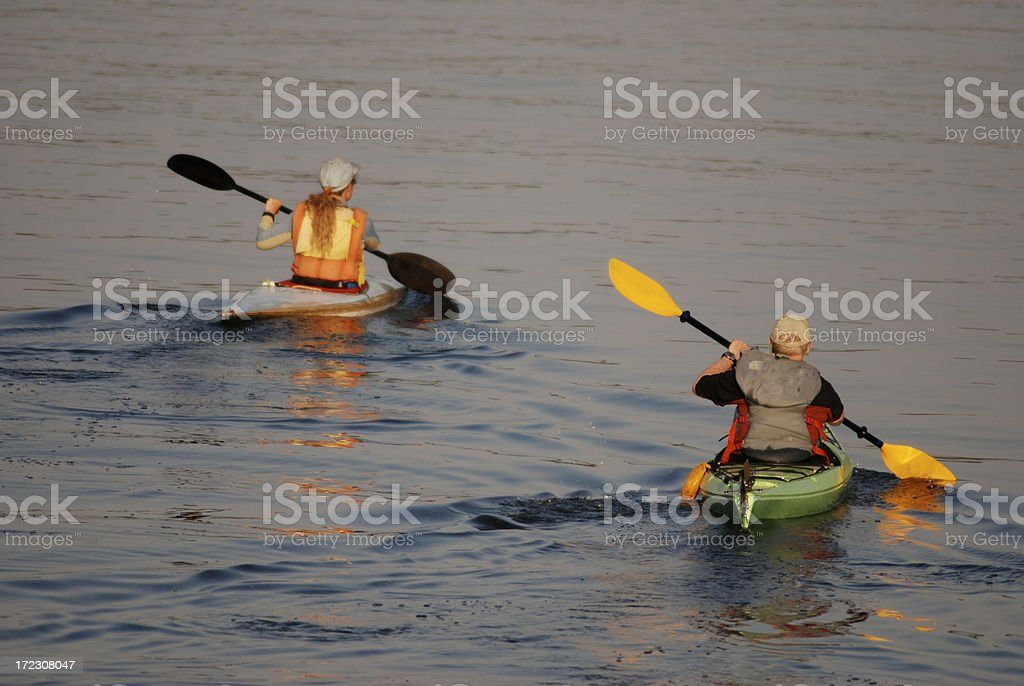 Twilight Kayak Paddlers, Great Slave Lake, Northwest Territories. royalty-free stock photo