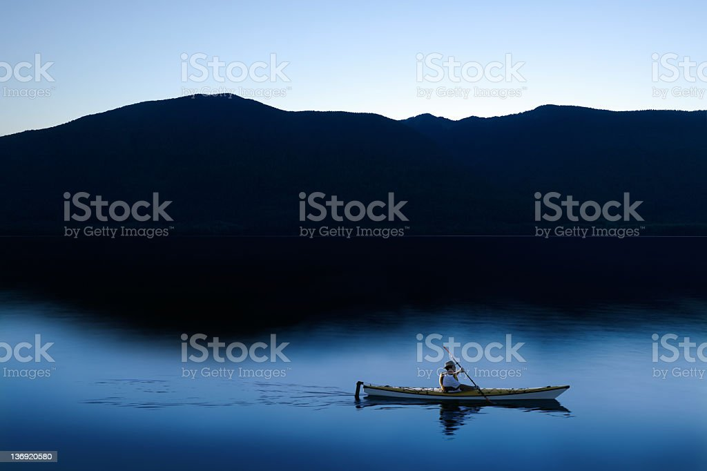 XXL twilight kayaker stock photo
