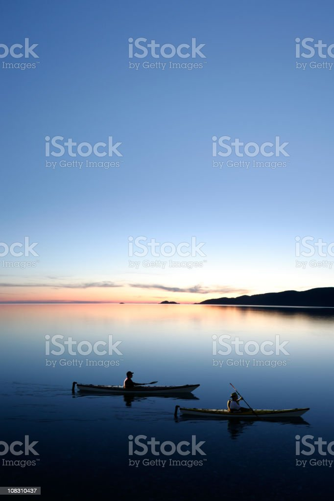 XXXL twilight kayakers stock photo