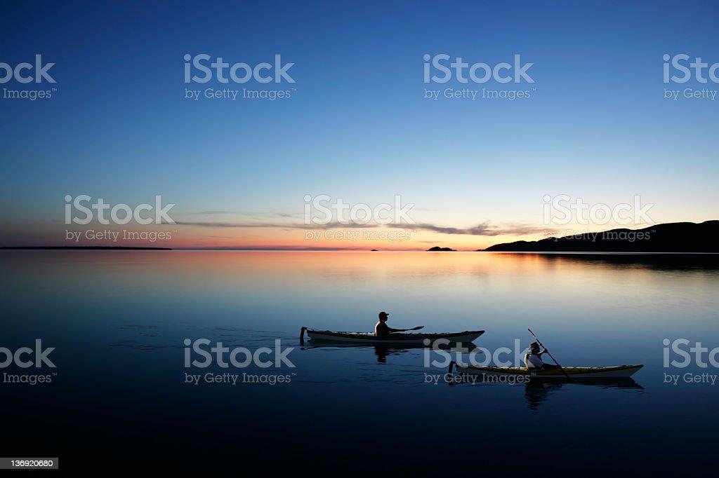 XXL twilight kayakers royalty-free stock photo