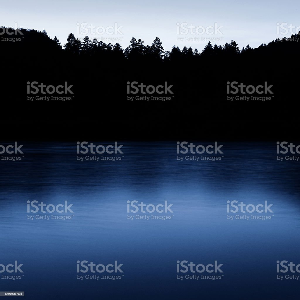 twilight lake and forest stock photo
