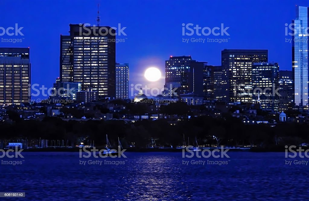 Twilight Moon Rising Over Boston stock photo