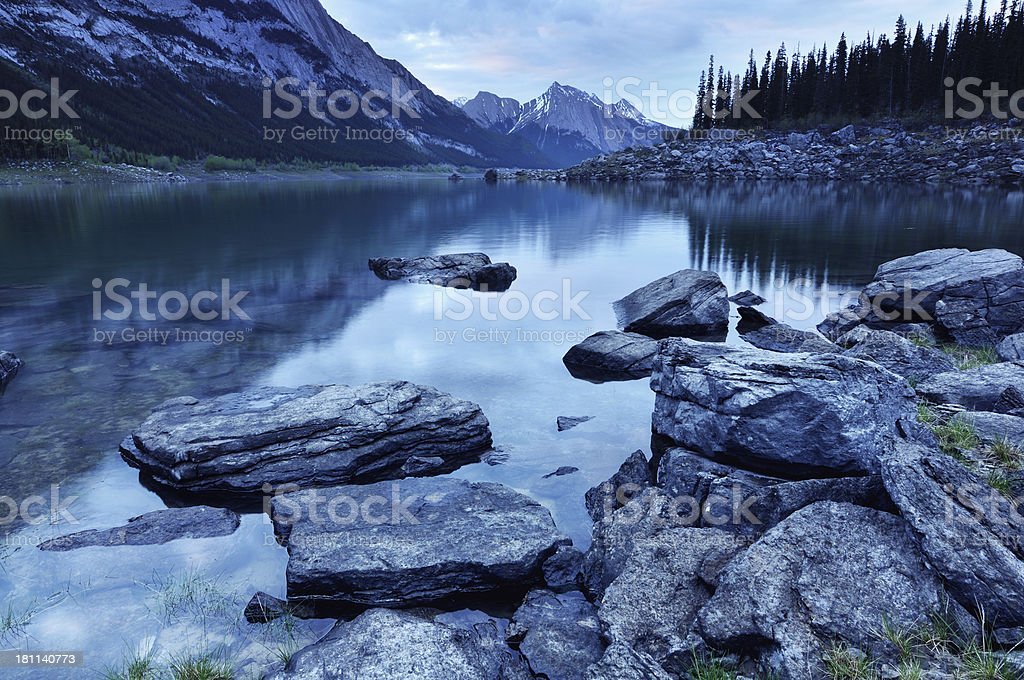 Twilight mountain landscape with Medicine Lake in Canadian Rokies stock photo