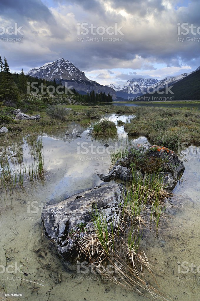 Twilight mountain landscape with reflection in lake at Canadian Rokies royalty-free stock photo
