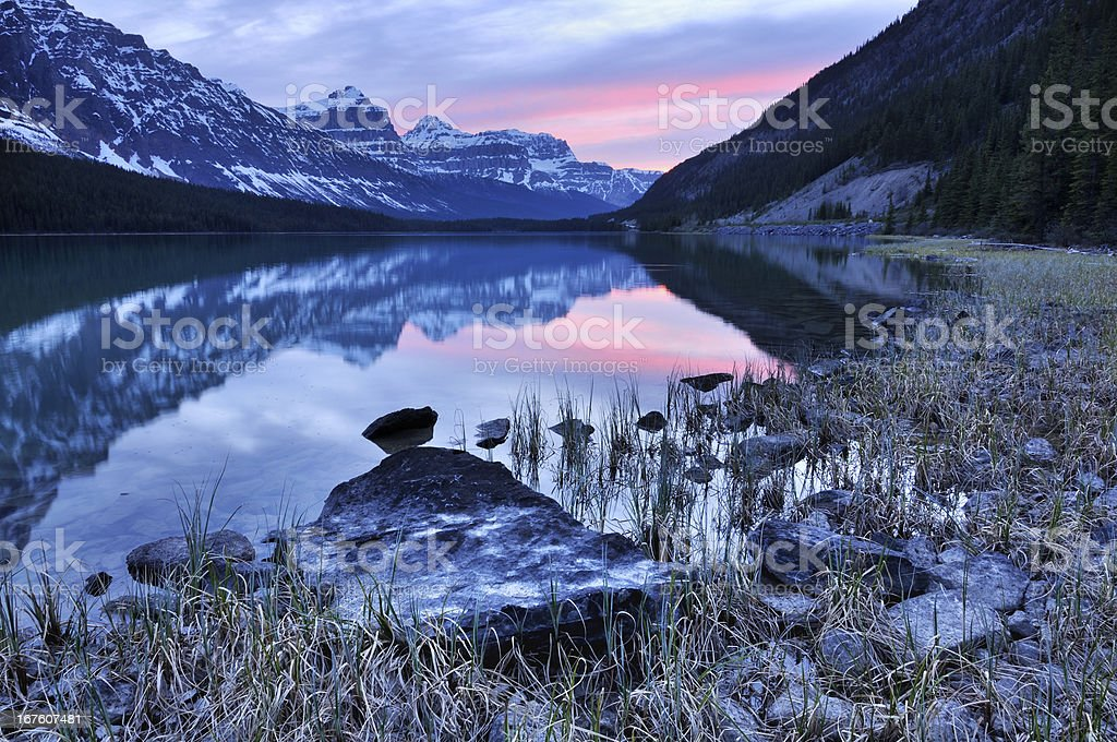 Twilight mountain landscape with reflection in Waterfowl Lake, Canadian Rokies stock photo