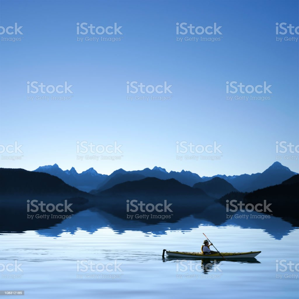 XXXL twilight ocean kayaking stock photo