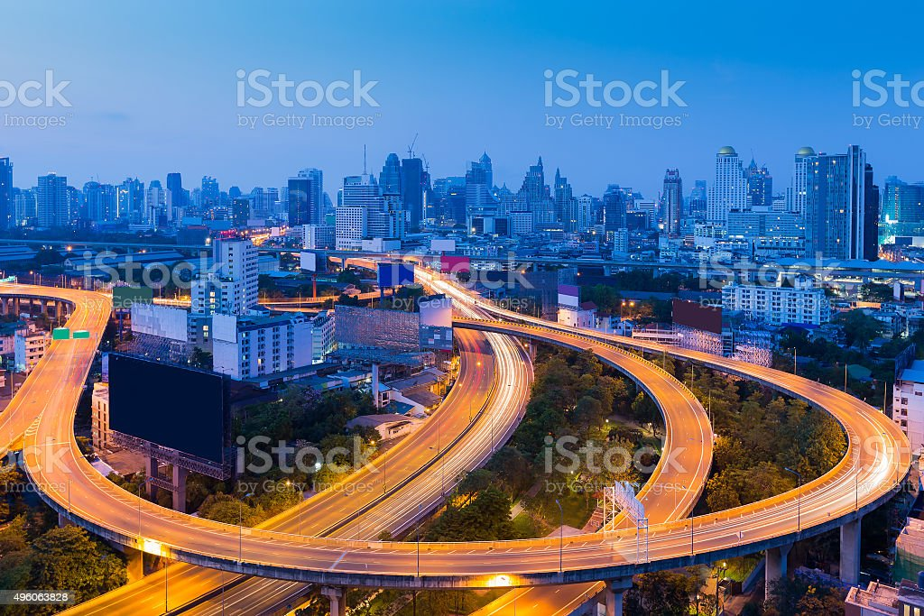Twilight of city downtown highway curved and interchange stock photo