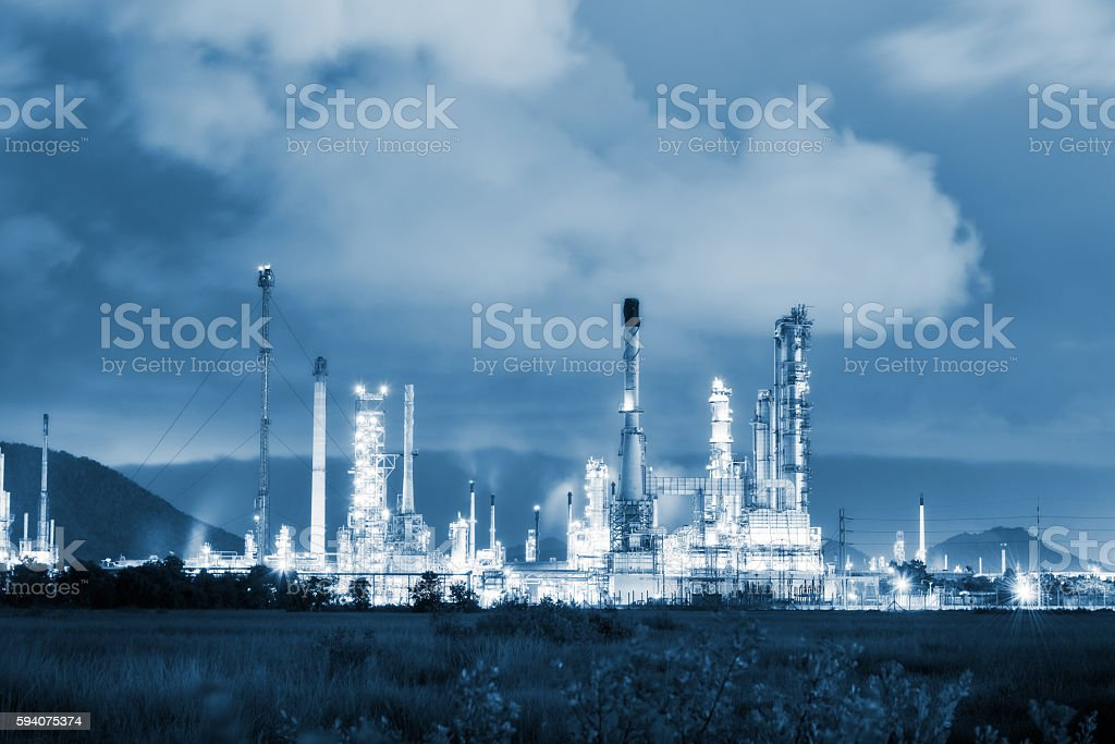 Twilight of oil refinery plant on blue tone color. stock photo