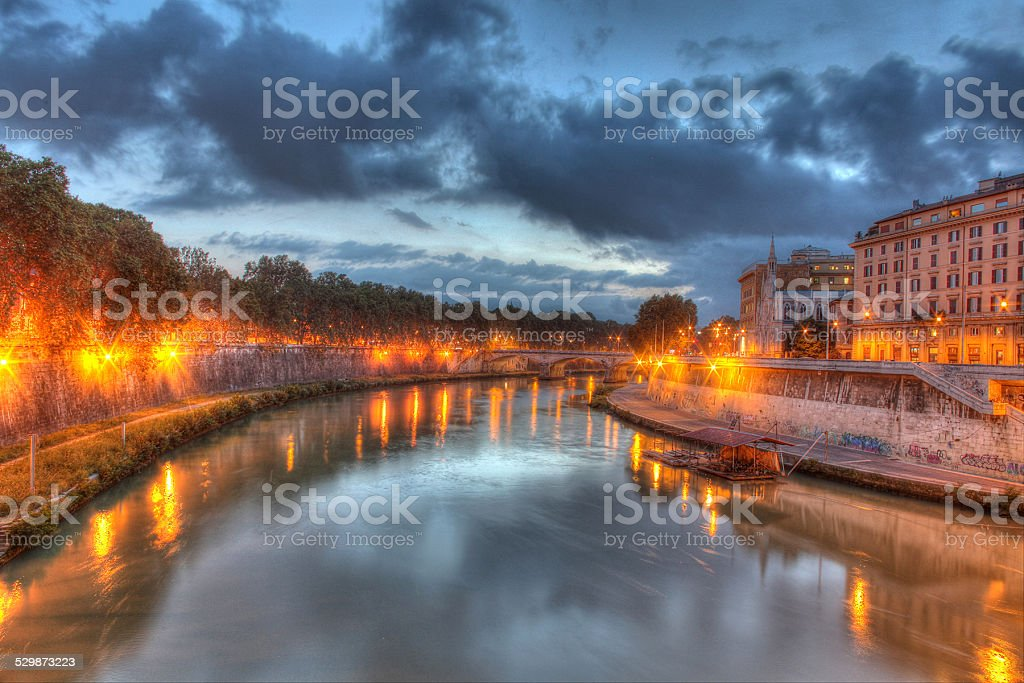 Twilight on a river in Rome stock photo