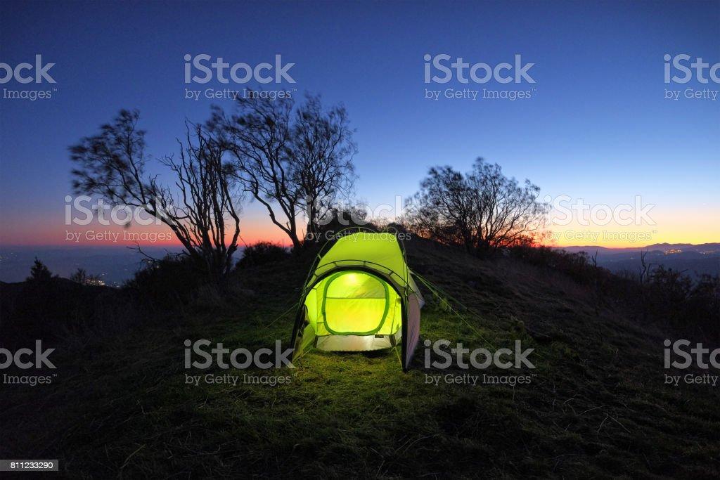 Twilight On Illuminated Tent In Etna Park, Sicily stock photo