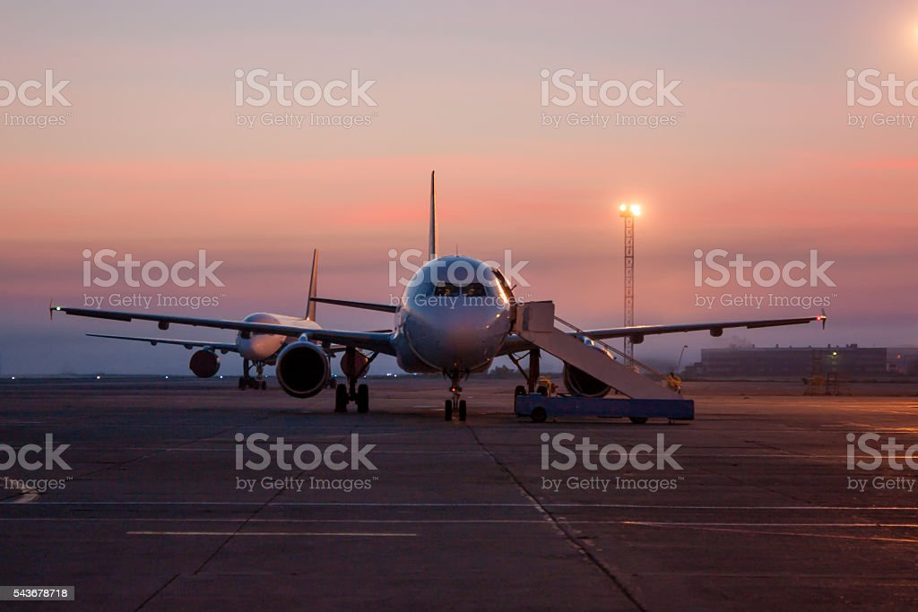 Twilight on the airport apron royalty-free stock photo