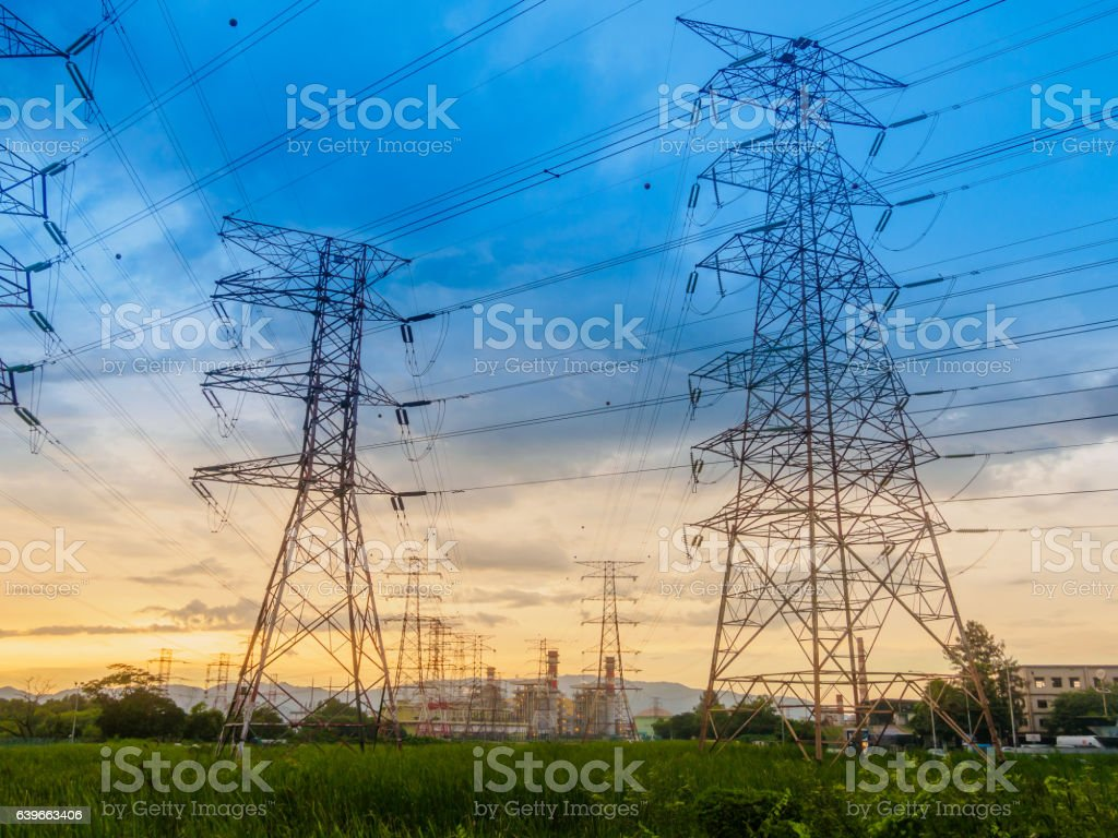 Twilight photo of High voltage post stock photo