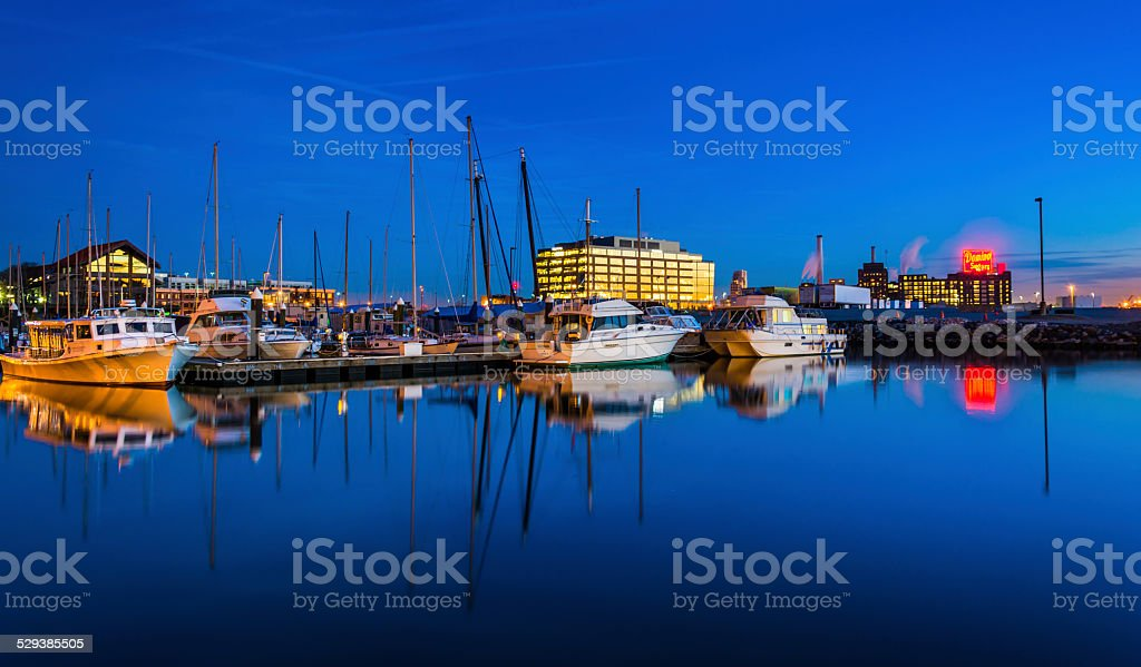 Twilight reflections in a marina in Harbor East, Baltimore, Mary stock photo