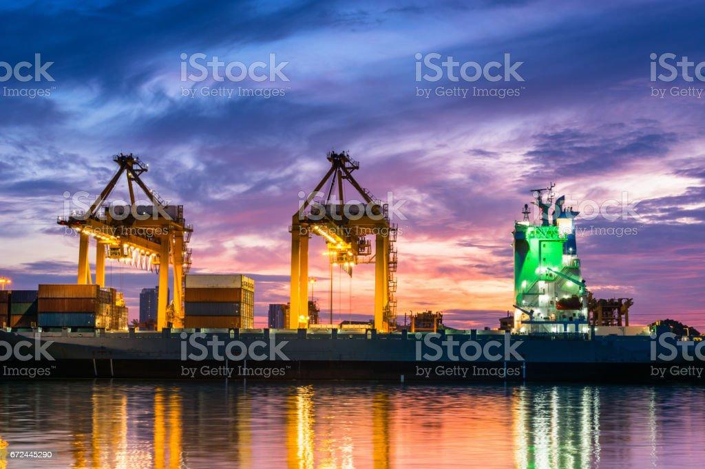 Twilight scene of terminal unloading container. stock photo